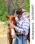 Cowboy Working His Horse In Th...