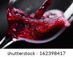 red wine in wineglass on ... | Shutterstock . vector #162398417