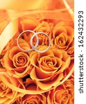 gold wedding rings on the... | Shutterstock . vector #162432293