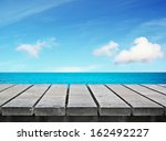 Wooden Table On  Sunny Day Nea...