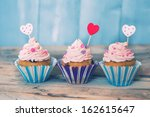 photo of 3 cupcakes on wooden... | Shutterstock . vector #162615647