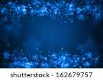 blue glowing star bokeh holiday ... | Shutterstock . vector #162679757