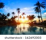 Stock photo beautiful sunset at a beach resort in tropics 162692003