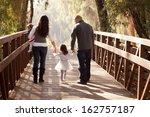happy family walking away... | Shutterstock . vector #162757187