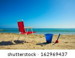 beach chair and plastic toy... | Shutterstock . vector #162969437