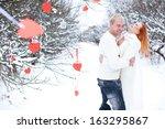 loving couple on a winter... | Shutterstock . vector #163295867