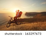 cyclist on a mountain bike... | Shutterstock . vector #163297673