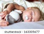 cute toddler sleeping in bed... | Shutterstock . vector #163305677