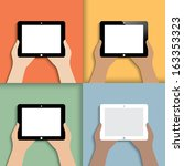 tablet in hands. icons in color....