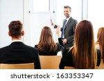 businessman giving a... | Shutterstock . vector #163353347