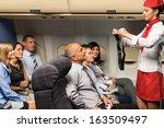 flight attendant safety demo... | Shutterstock . vector #163509497