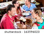 young people in traditional... | Shutterstock . vector #163596023