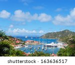 Small photo of ST BARTS, FRENCH WEST INDIES - JANUARY 19:Aerial view at Gustavia Harbor with mega yachts on January 19, 2005 at St Barts. The island is popular tourist destination during the winter holiday season