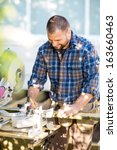 happy mid adult carpenter...   Shutterstock . vector #163660463
