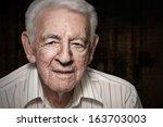 Old Senior Man Closeup Serious...