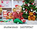 Cheerful Little Boy Playing...
