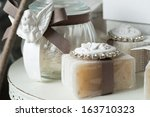 favors on a table outdoor with... | Shutterstock . vector #163710323