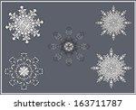 vector set of ornate snowflakes ... | Shutterstock .eps vector #163711787
