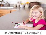 child drawing with crayons ... | Shutterstock . vector #163956347