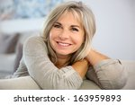 smiling senior woman sitting in ... | Shutterstock . vector #163959893
