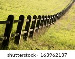 Wooden Fence In The Grasslands