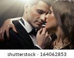 sensual portrait of cute couple  | Shutterstock . vector #164062853
