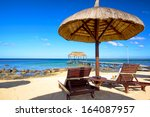 beach beds  umbrella and jetty... | Shutterstock . vector #164087957