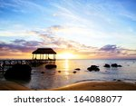 jetty silhouette against sunset ... | Shutterstock . vector #164088077