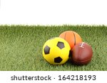 balls and green grass on white... | Shutterstock . vector #164218193