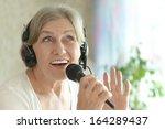 Senior Woman Singing Into...