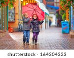 Happy Kids Walking Under The...