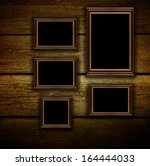 blank photo frame on the grunge ... | Shutterstock . vector #164444033