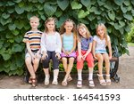 five children friends sit on... | Shutterstock . vector #164541593