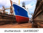 cargo ship is being renovated... | Shutterstock . vector #164580287