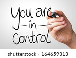Small photo of You are in Control hand writing with a black mark on a transparent board