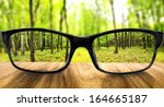 clear forest in glasses on the... | Shutterstock . vector #164665187