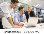 a business team of three in... | Shutterstock . vector #164709797