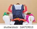 a woman opening christmas...   Shutterstock . vector #164719013