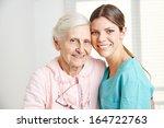 smiling caregiver embracing... | Shutterstock . vector #164722763