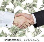 handshake over 100 dollar bills. | Shutterstock . vector #164734673