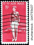 Small photo of USA - CIRCA 1963: A stamp printed by USA shows image portrait of an American aviation pioneer and author Amelia Earhart, circa 1963.