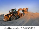 sunset on a bulldozer in action