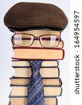 Small photo of Joky image of the intellectual: books, eyeglasses, a necktie