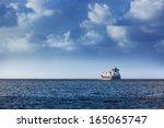 cargo ship in the ocean in the...