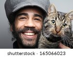 Stock photo smiling man with cat 165066023