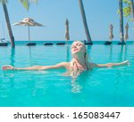 in a pool gorgeous female  | Shutterstock . vector #165083447