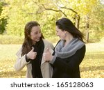 happy women showing thumb up | Shutterstock . vector #165128063