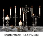 Burning Candles On Silver...