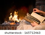 hands of woman reading book by... | Shutterstock . vector #165712463