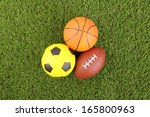 balls on green grass background | Shutterstock . vector #165800963